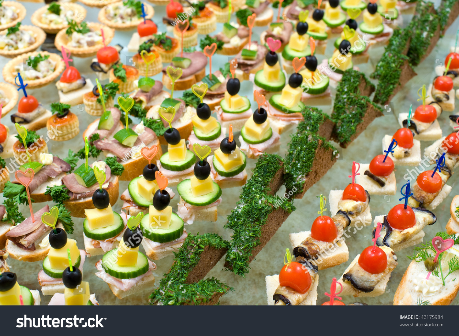 Canapes skewers sandwiches on buffet table stock photo for Canape table