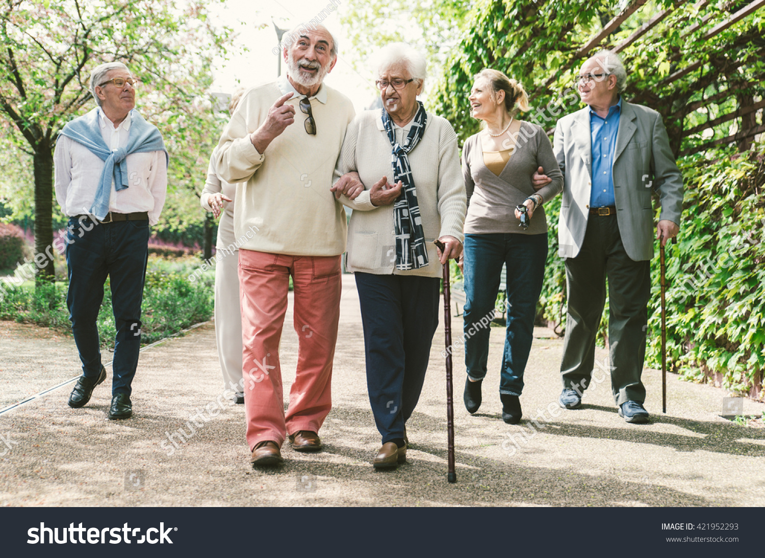 group old people walking outdoor stock photo (royalty free