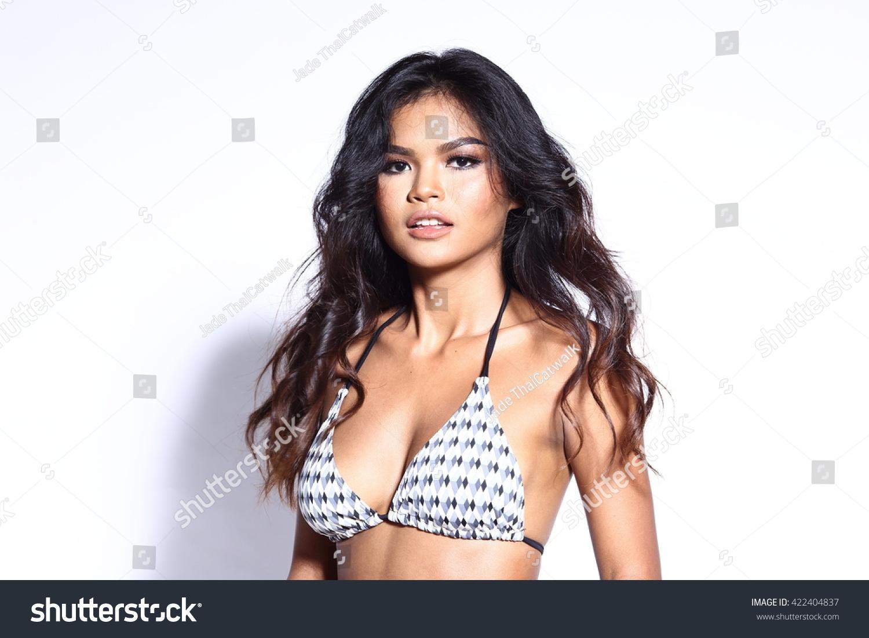 https://image.shutterstock.com/z/stock-photo-beautiful-asian-thai-model-woman-in-tan-skin-black-white-pattern-sport-swim-suit-fashion-make-up-on-422404837.jpg