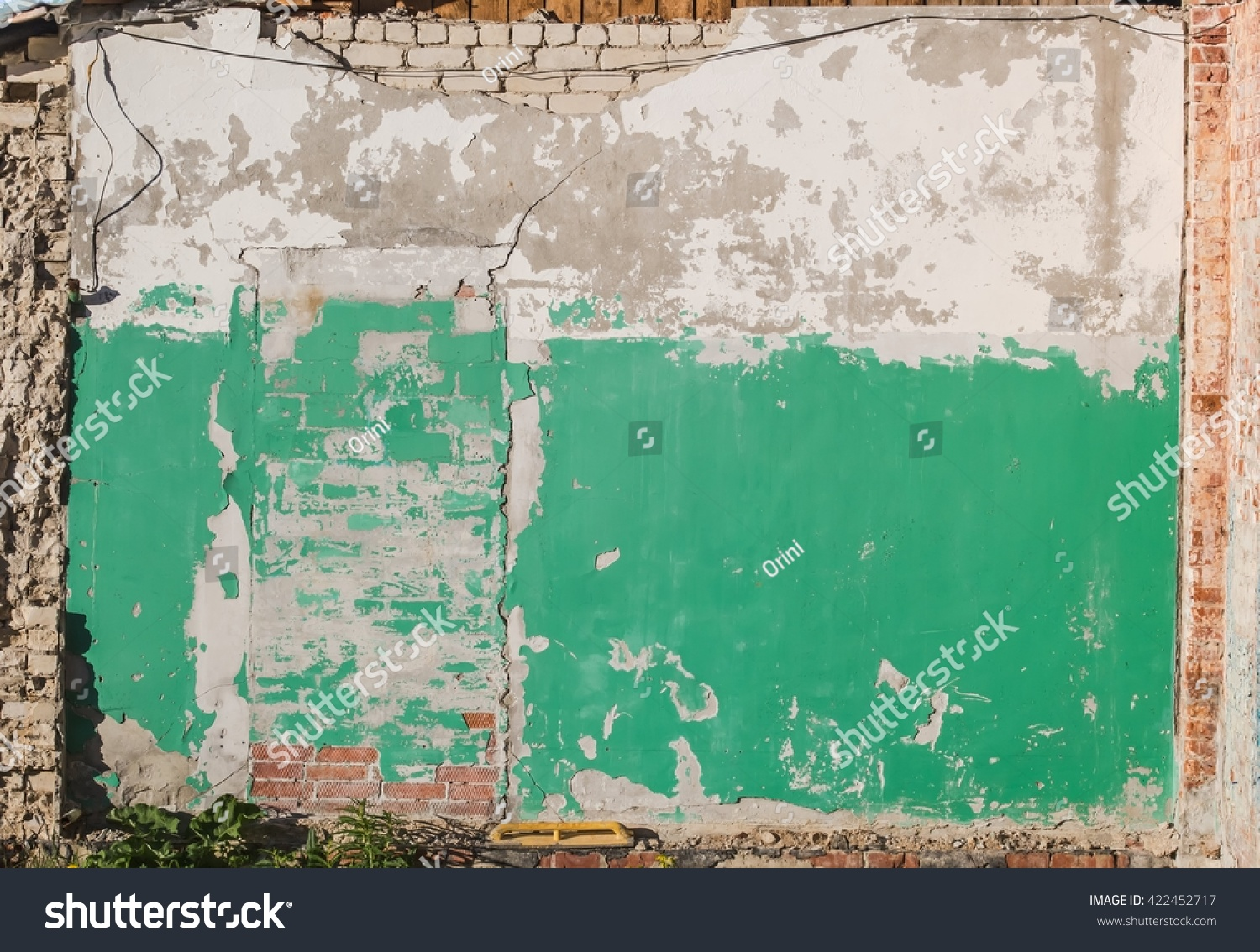 Old crumbling painted brick wall with bricked up doorway. Architectural details for texture or background & Old Crumbling Painted Brick Wall Bricked Stock Photo 422452717 ... Pezcame.Com