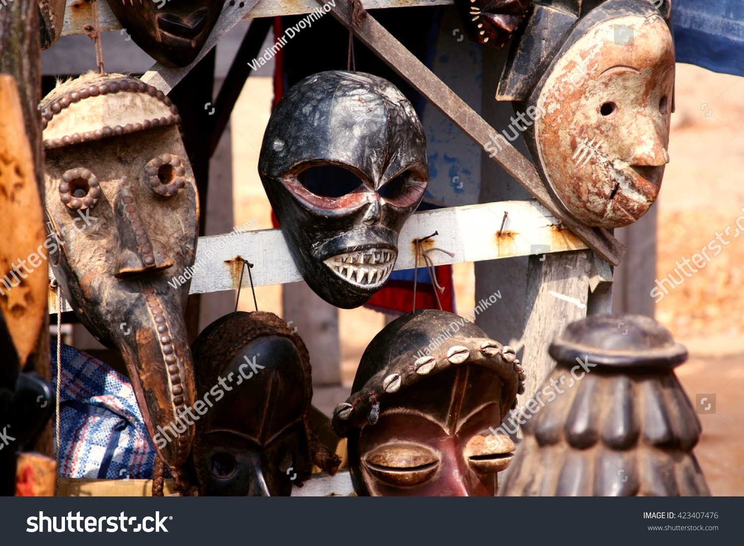 traditional african masks related to voodoo religion for sale at the market of annual beninese voodoo