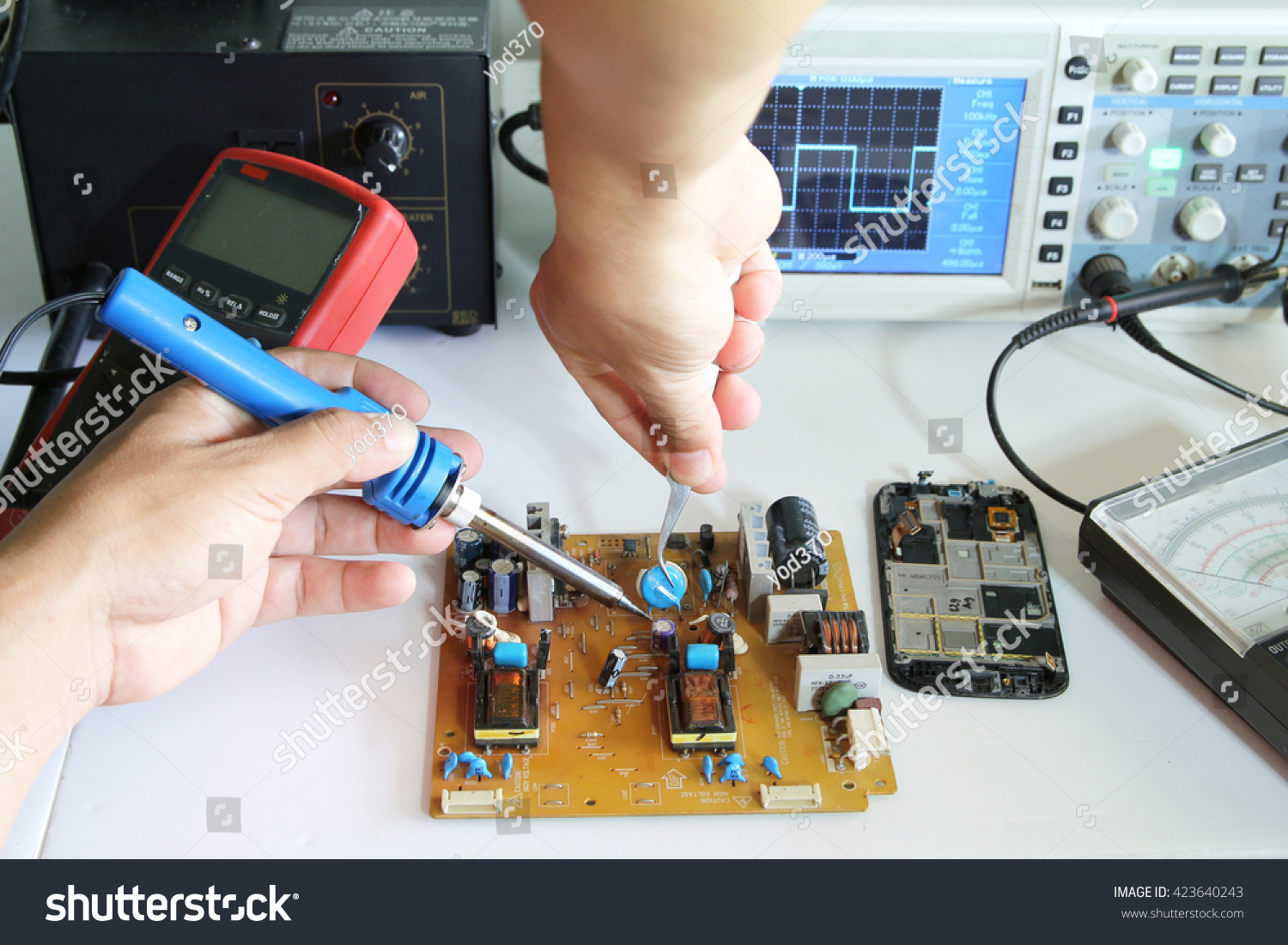 Soldering Electronic Parts On Tablet Circuit Stock Photo Edit Now Of A Board
