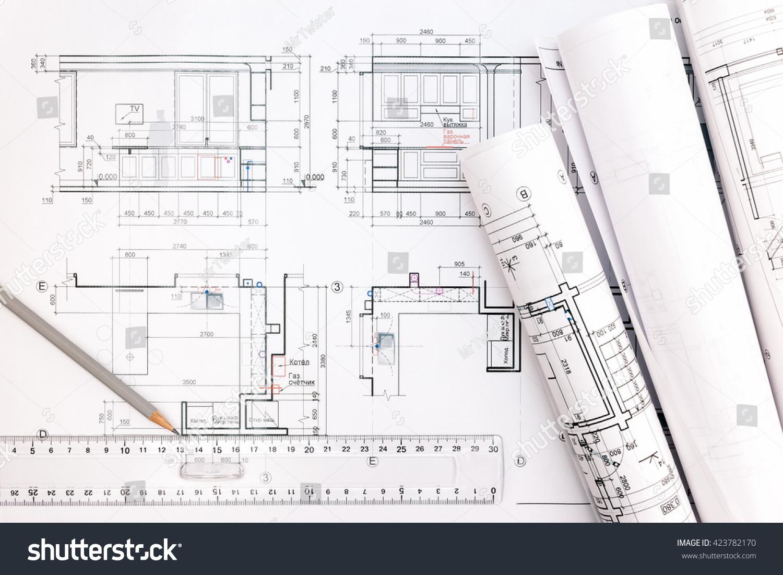 Architectural blueprints blueprint rolls pencil ruler stock photo architectural blueprints and blueprint rolls with pencil and ruler malvernweather Choice Image