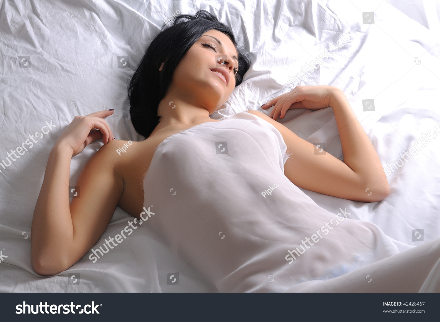beautiful brunette girl lying naked bed stock photo & image (royalty