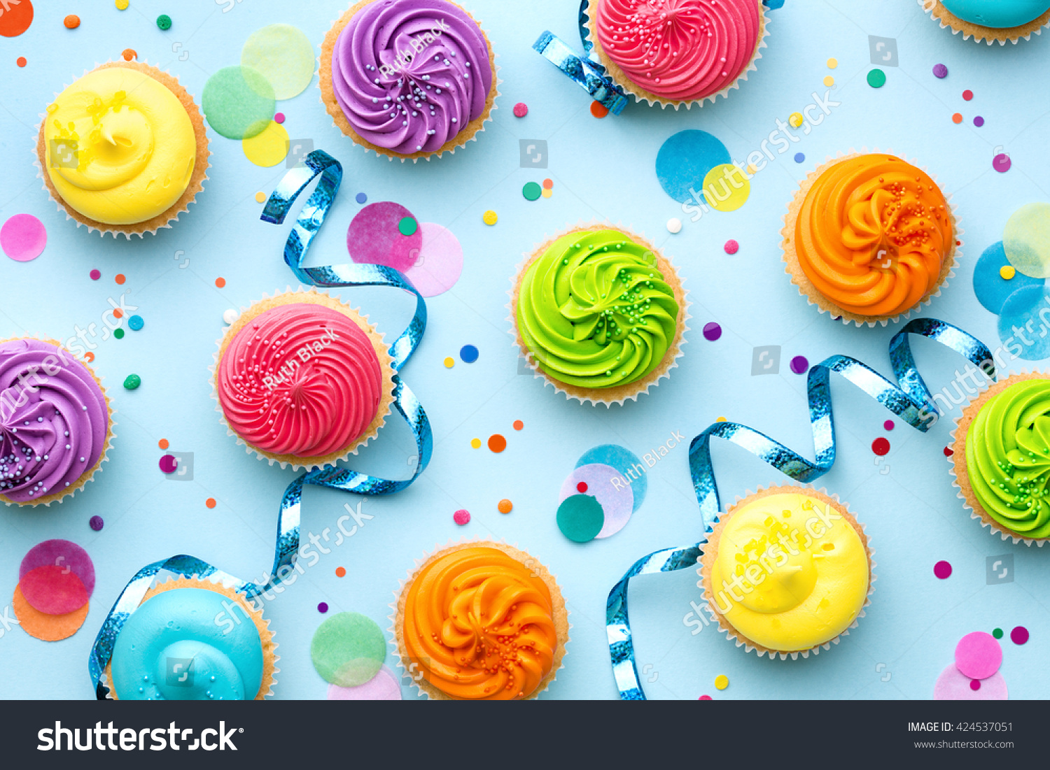 Colorful Cupcake Party Background On Blue Stock Photo
