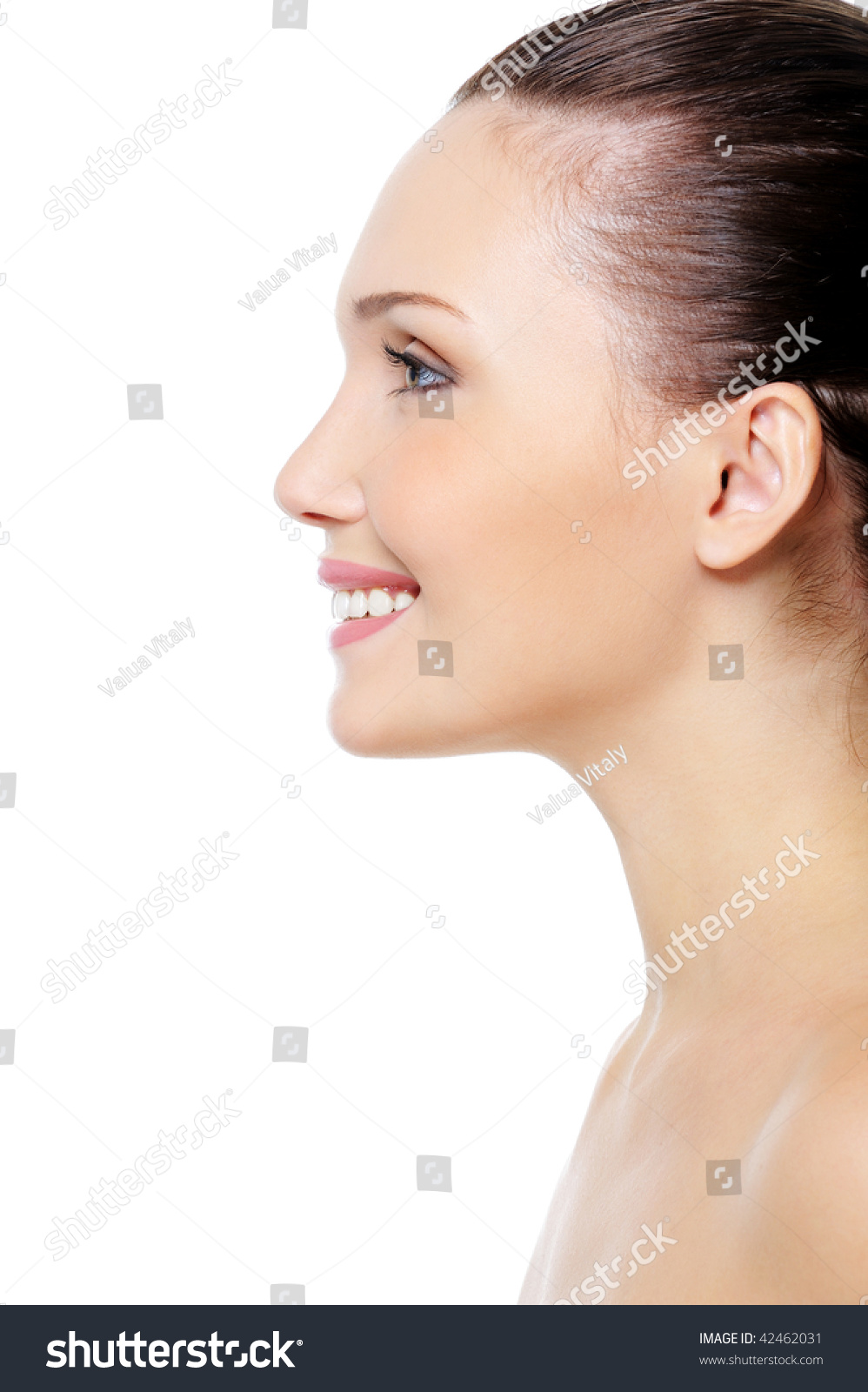 beautiful young womans face with healthy clean fresh skin