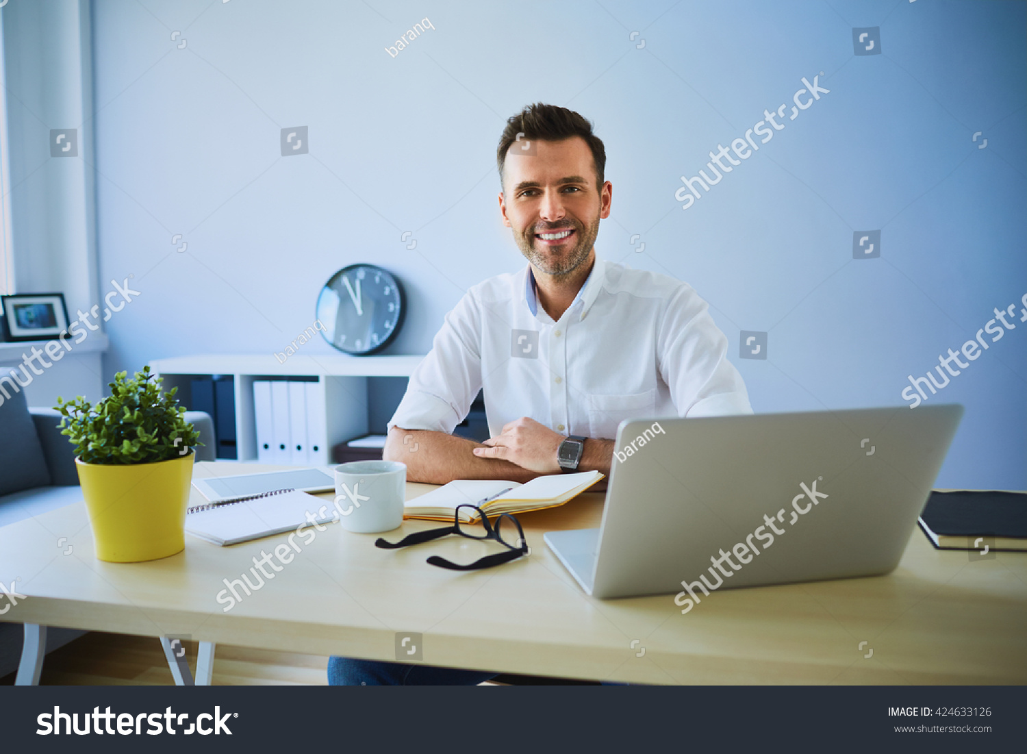 running home office. Happy Man Running Small Business From His Home Office Looking At Camera With Laptop , Glasses A