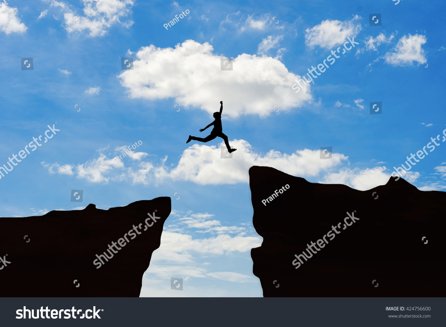 Man Jump Through The Gap Between Hilln Jumping Over Cliff On