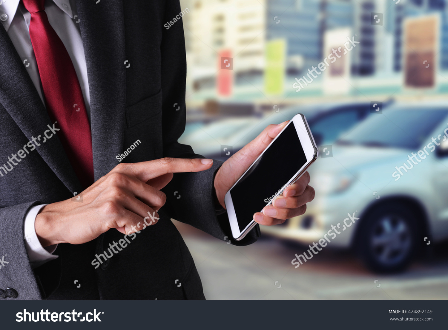business hand hold smart phone buy car on internet concept background
