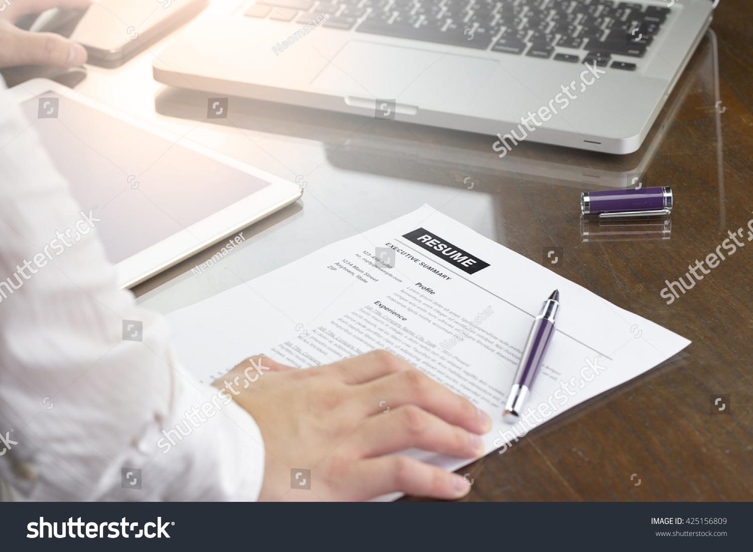 businessman review his resume on his stock photo 425156809