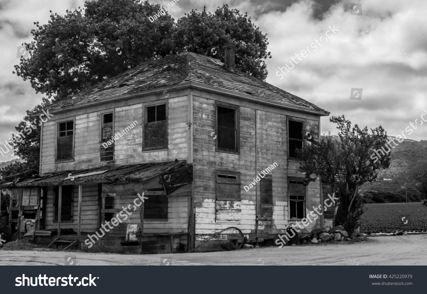 Old abandoned farm house, black and white in Salinas Valley, California.