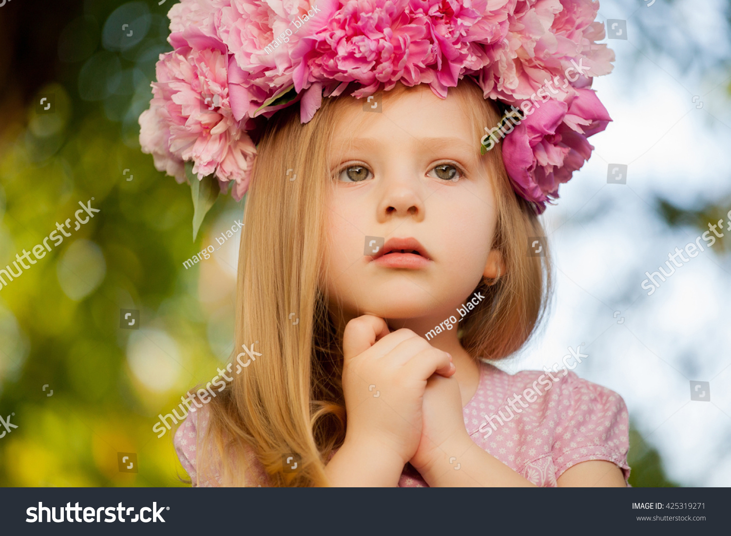 beautiful baby girl pink flowers outdoors stock photo (royalty free