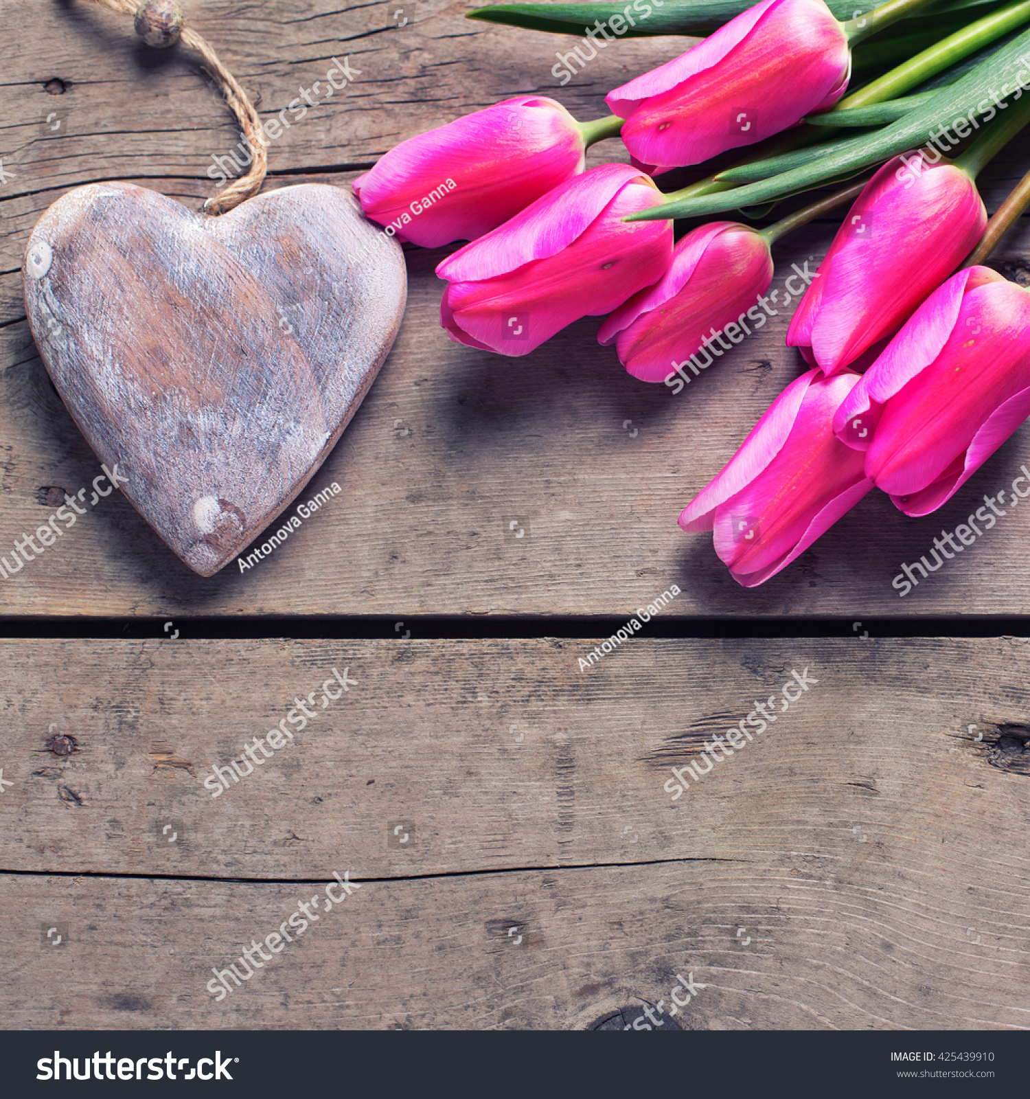 Pink Spring Tulips And Decorative Rustic Heart On Vintage Wooden Background Selective Focus Place