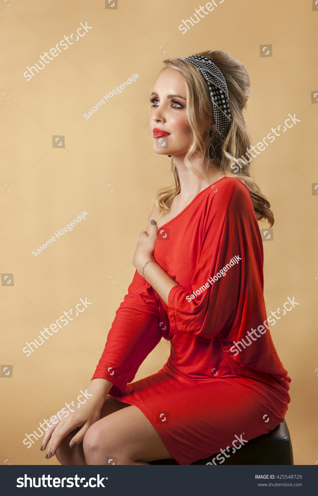 27b46ba69d1e Portrait of sexy blonde woman wearing vintage sixties red dress with retro  hairstyle and makeup
