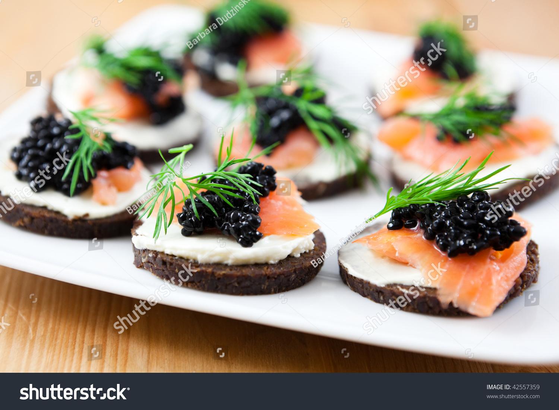 Delicious canapes salmon caviar stock photo 42557359 for Canape with caviar