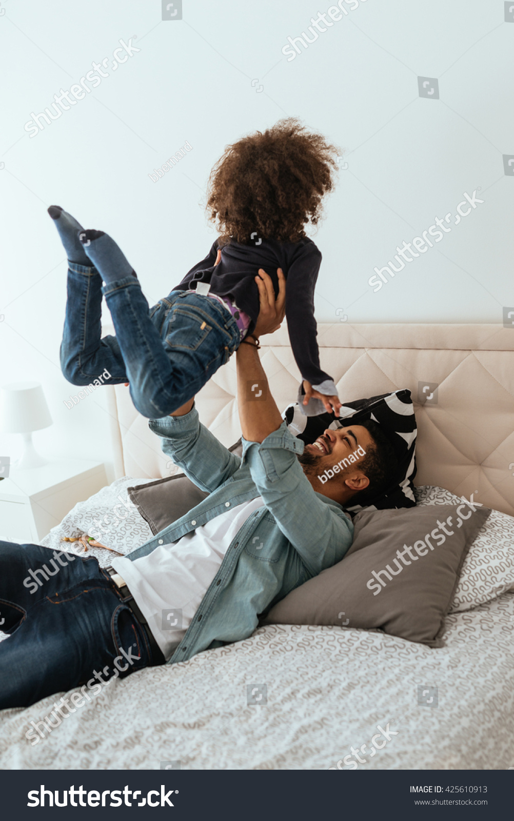 Dad and his girl playing in the bed