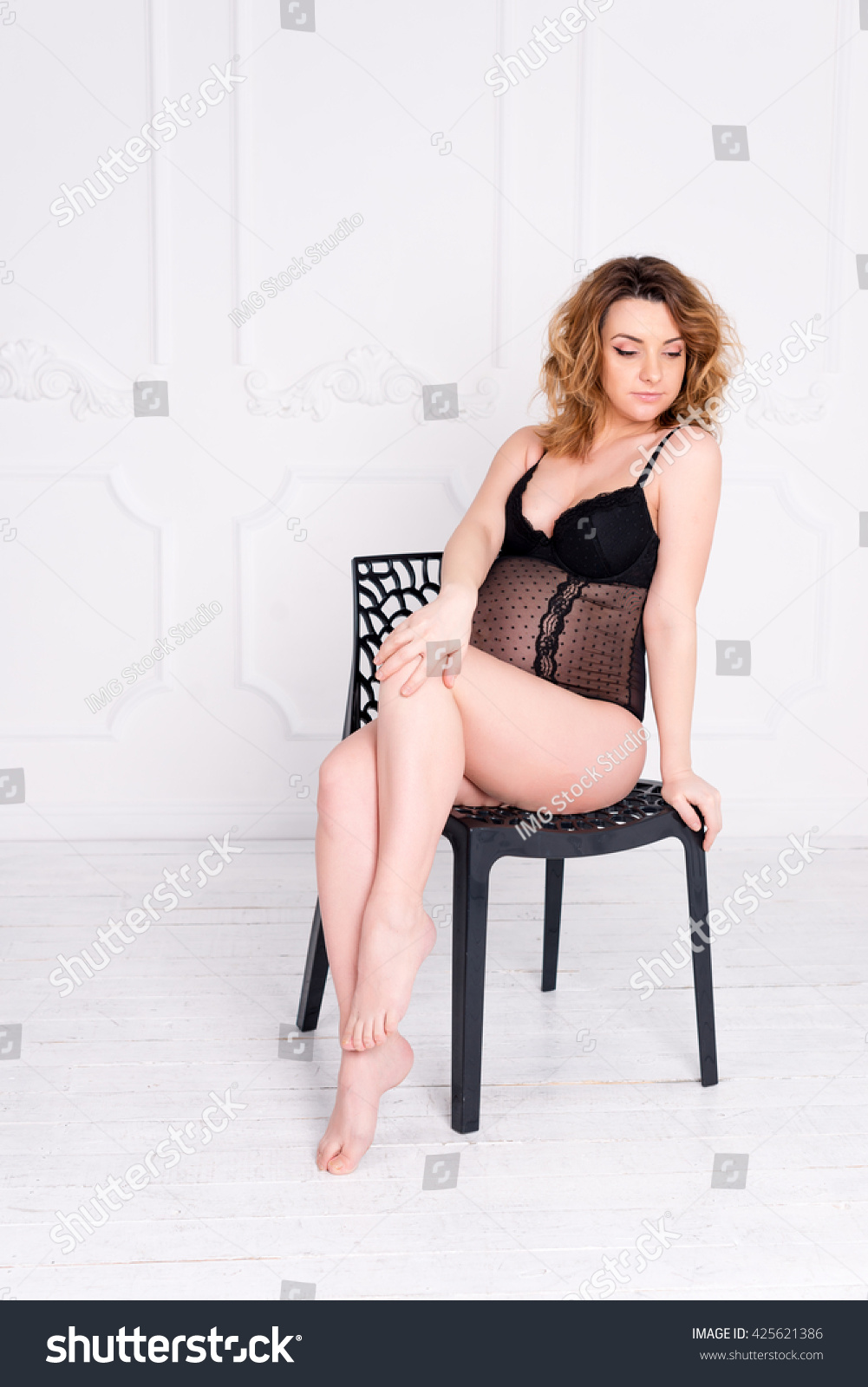 b16183a98 Young pregnant woman wearing lace lingerie in white interior. Fashion shot