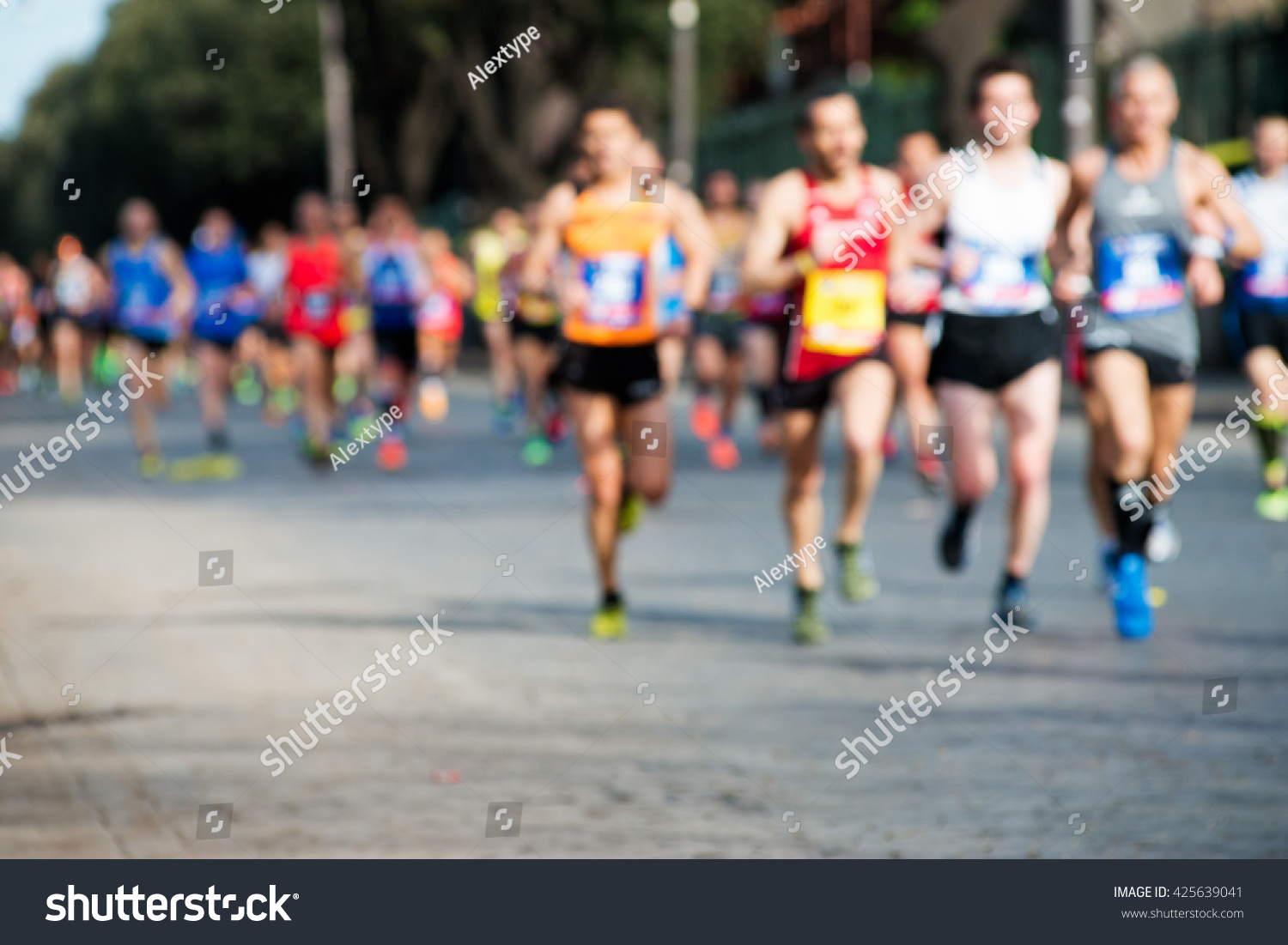 group of marathon runners, abstract blurry picture #425639041