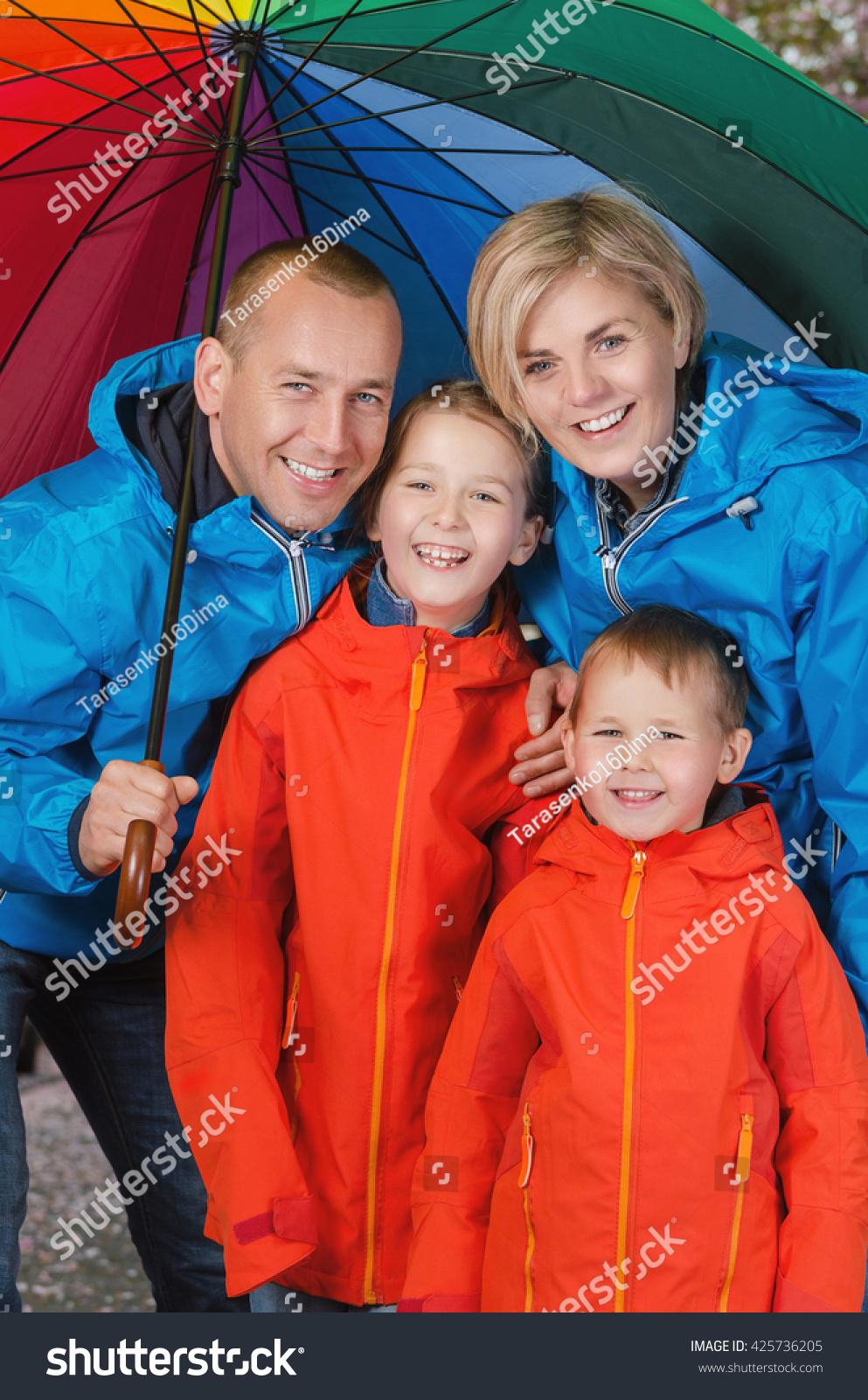 Happy Colorful Family Under Umbrella Rainy Stock Photo (Edit Now ...