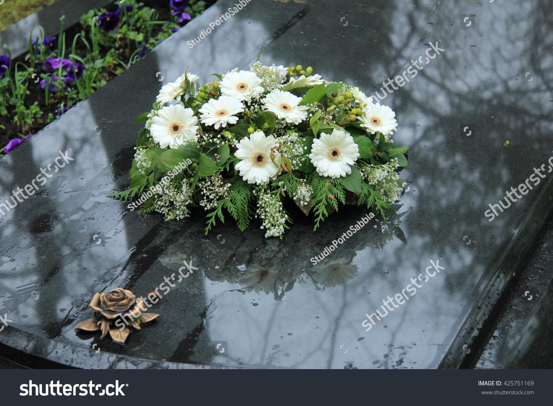 White funeral flowers on grey marble stock photo edit now white funeral flowers on a grey marble tomb izmirmasajfo