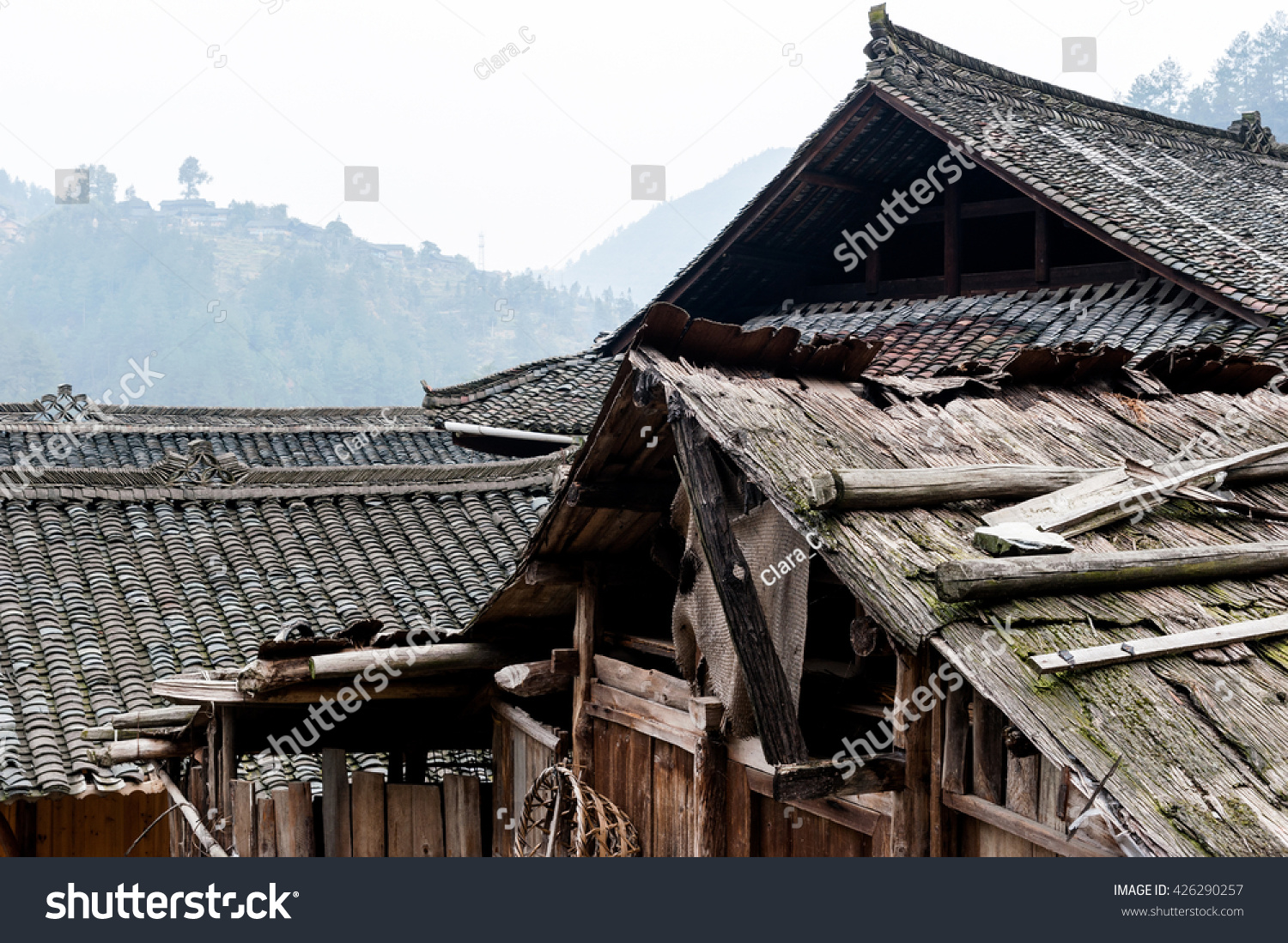 Old traditional houses roofs langde miao stock photo for Old traditional houses
