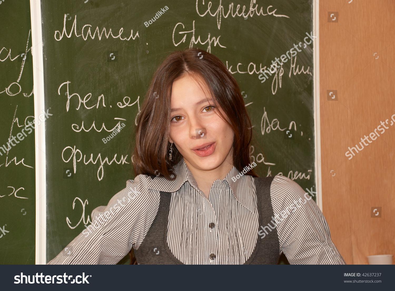 russian schoolgirl Russian schoolgirl performs the task at the blackboard