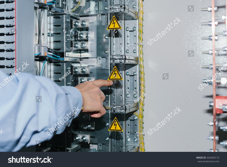 electrician near lowvoltage cabinet uninterrupted power stock electrician near the low voltage cabinet uninterrupted power supply electricity