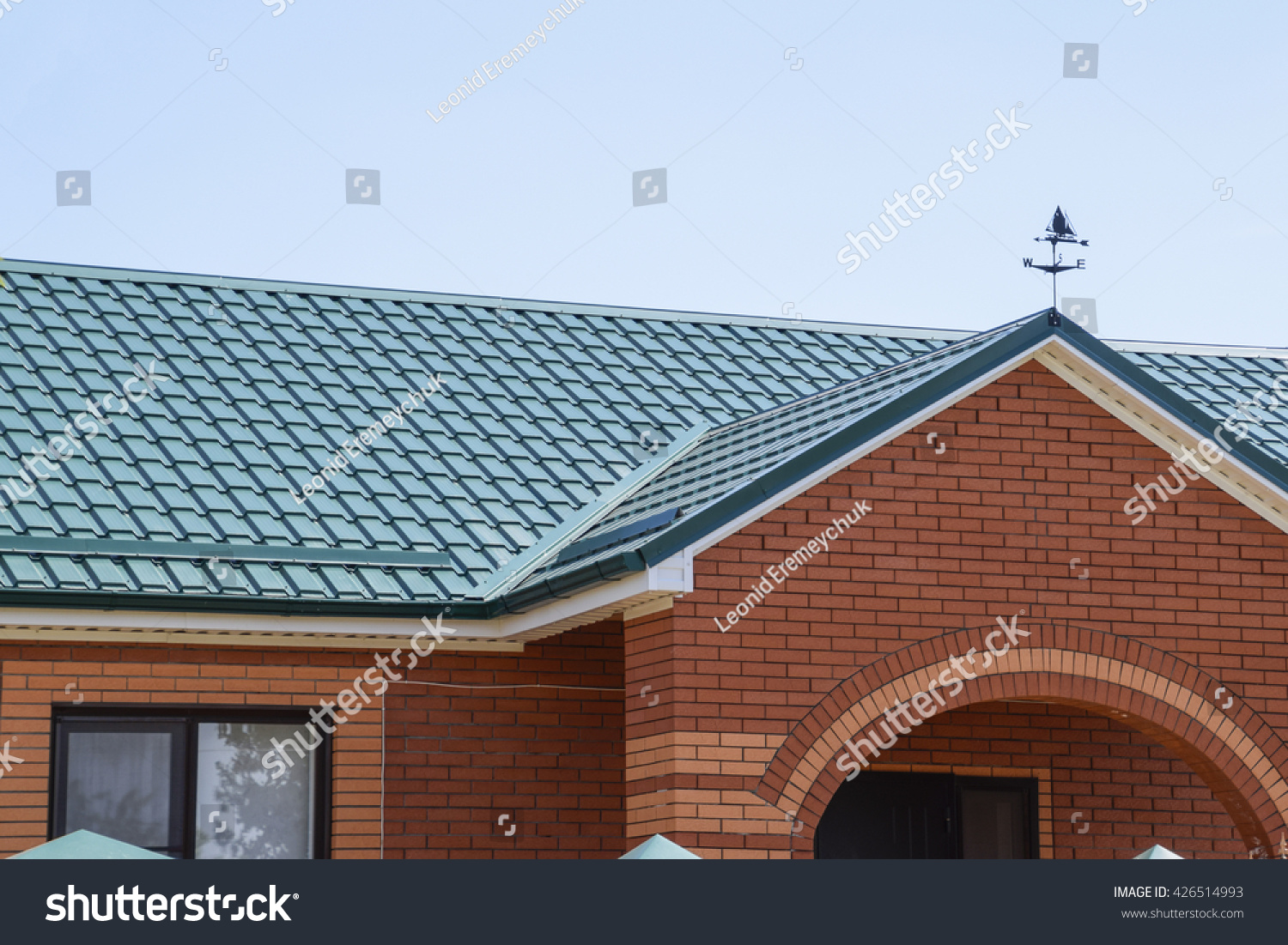 Facade brick building green roof made stock photo for Modern roofing materials