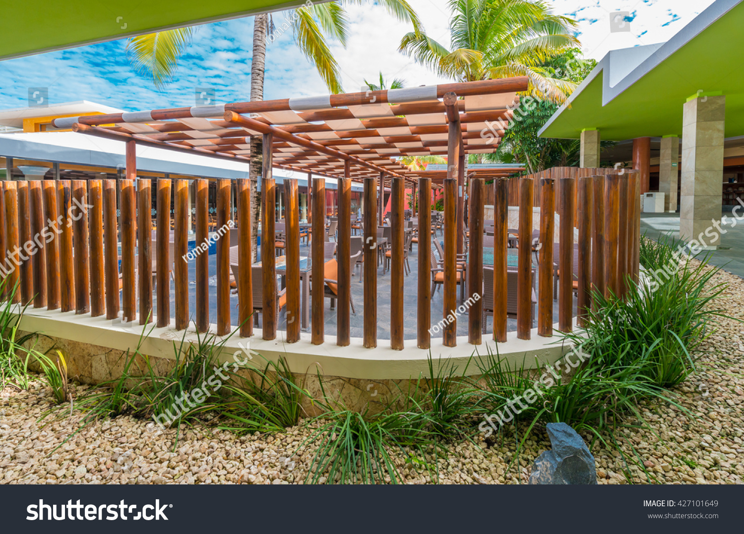behind decorative fence tropical caribbean style stock photo
