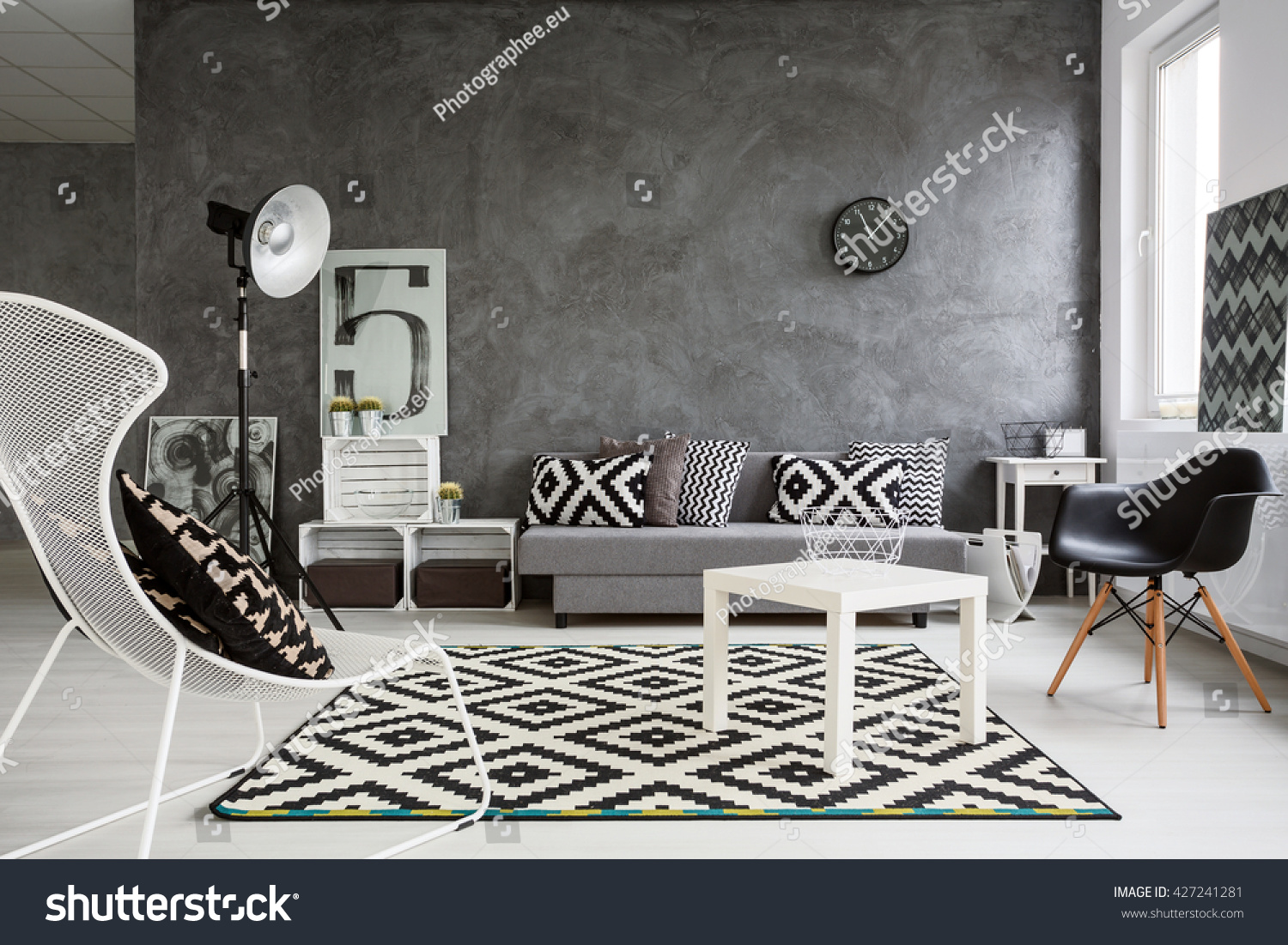 Spacious classic living room in black and white. Interior designed with style #427241281