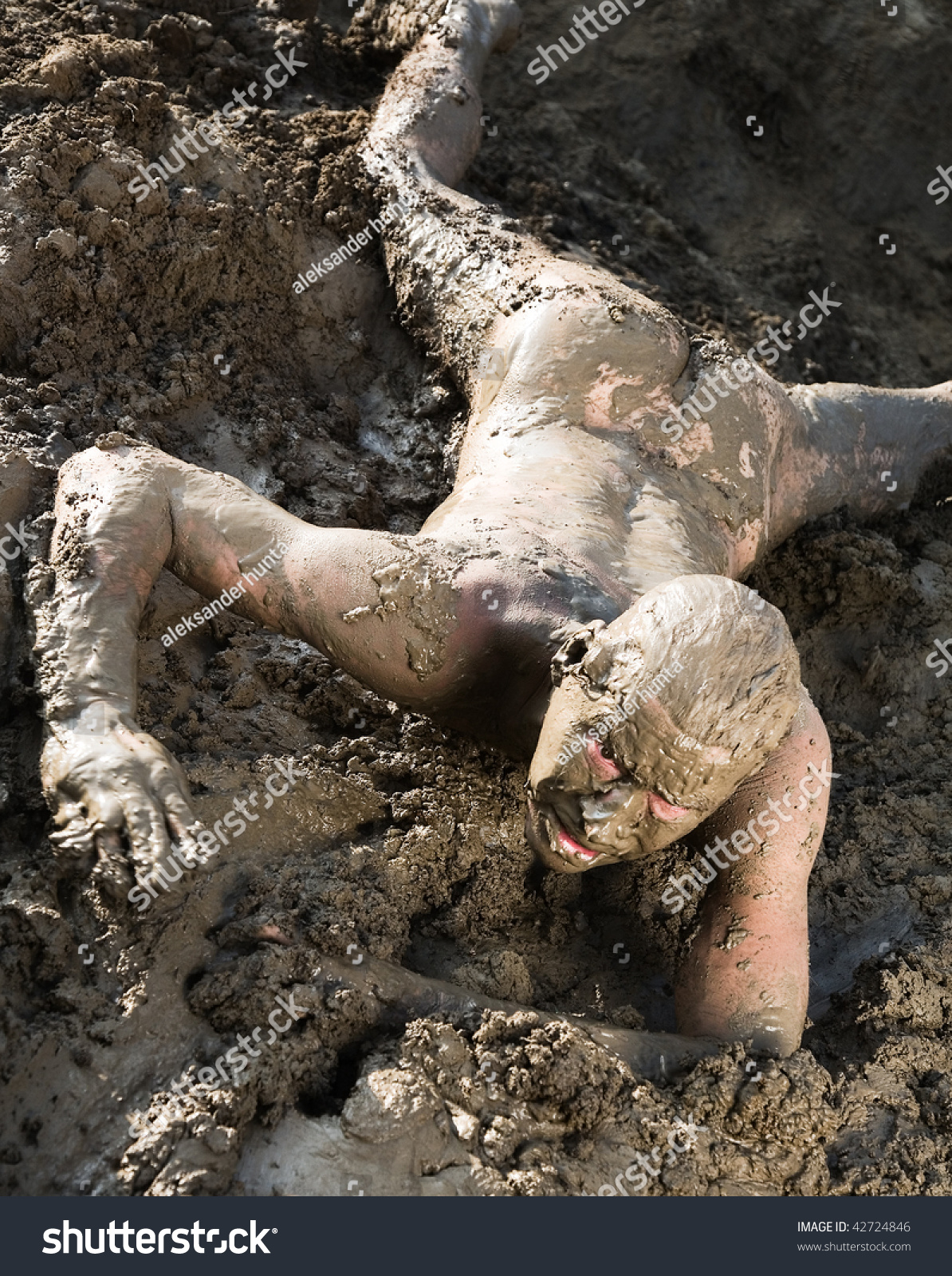 girls nude covered in mud