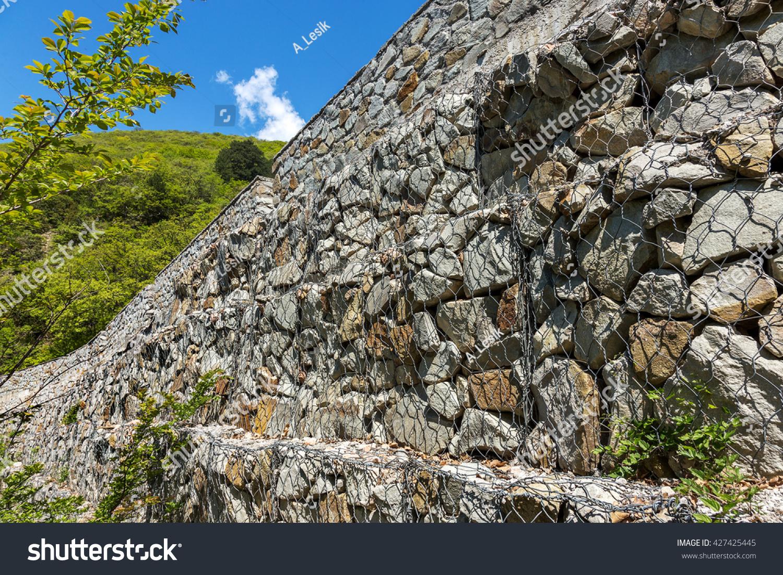 Stone blocks prevent landslides seismic rock stock photo