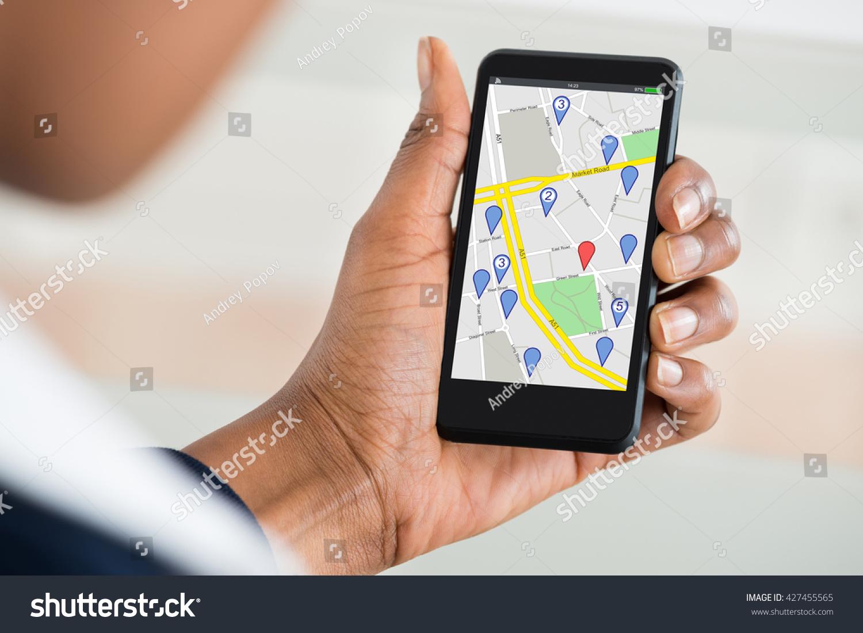 close womans hand holding mobile phone photo libre de droits 427455565 shutterstock. Black Bedroom Furniture Sets. Home Design Ideas