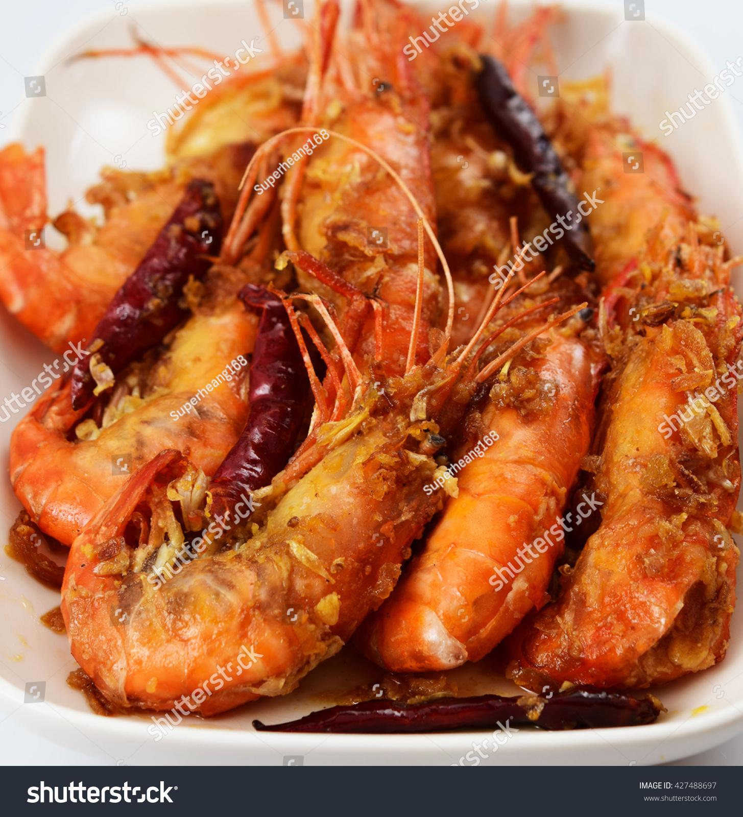 Close up, King prawns in sweet tamarind sauce and deep fried garlic