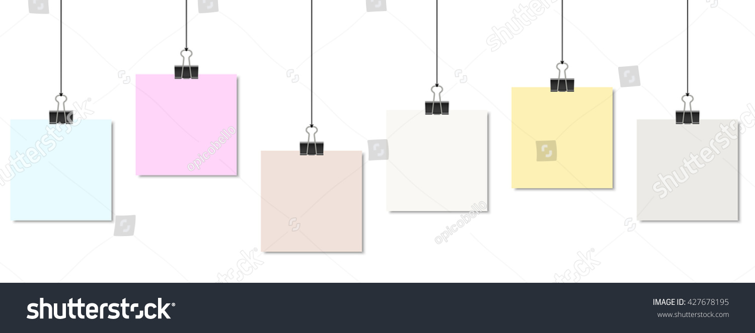 Empty Colored Papers With Binder Clips Hanging At Black Twine