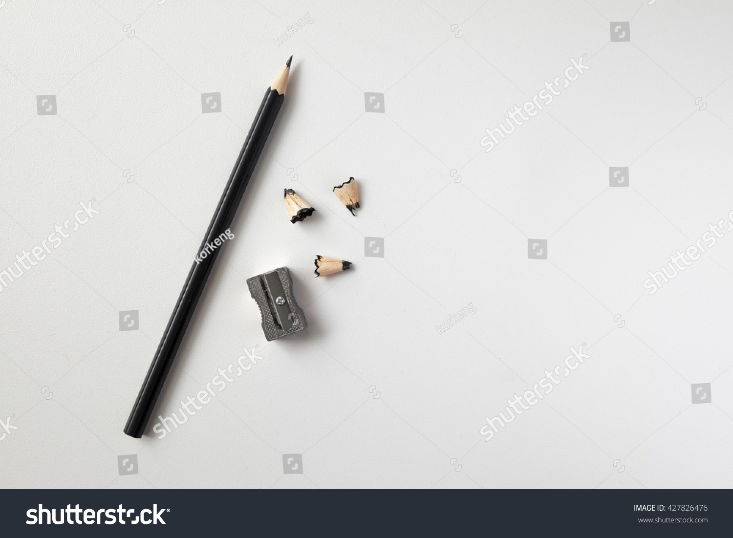 Pencil with sharpening shavings on white background #427826476