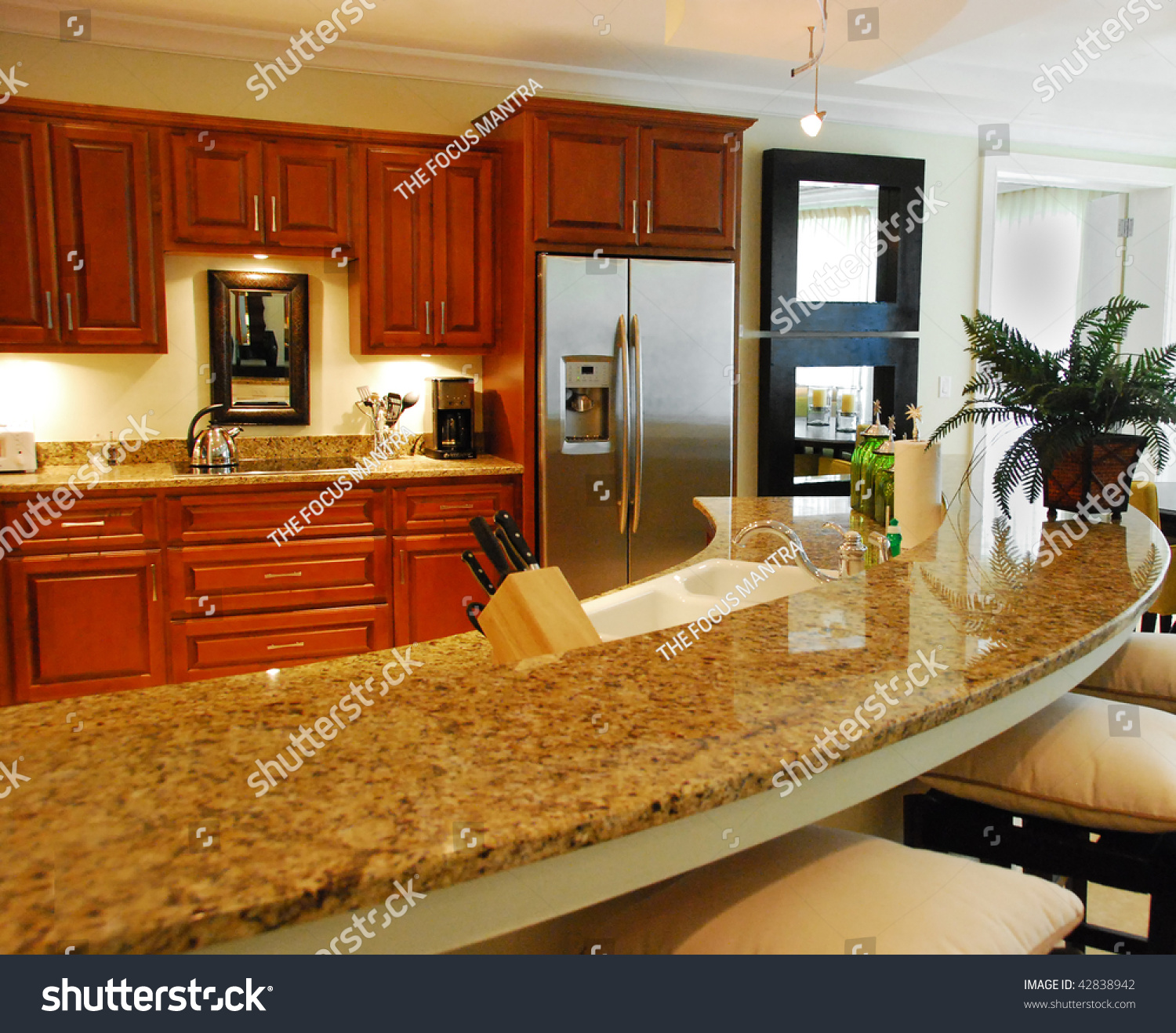 Kitchen Background Image: Granite Kitchen Counter With Cabinets In Background Stock