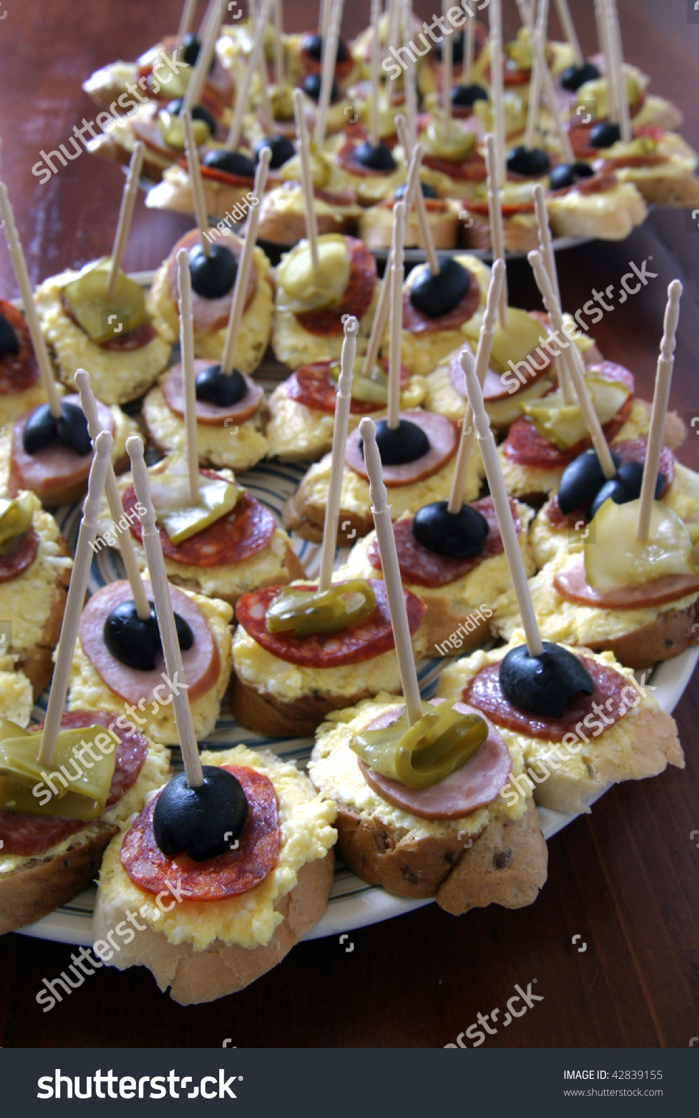 Canapes with garlic spread salami olives and pickles for Canape spreaders
