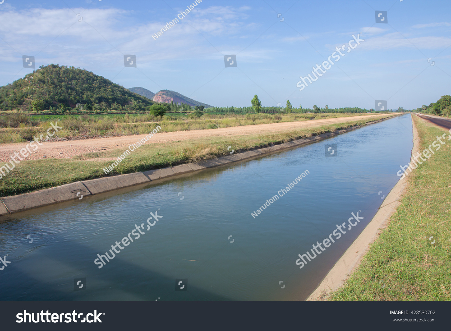 Agricultural Irrigation Canal : Irrigation canal between agricultural crops thailand stock