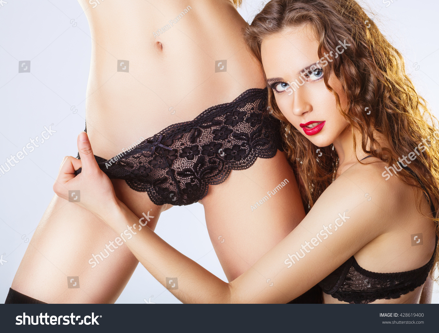 Two Beautiful Lesbian Women In Erotic Foreplay Game On A White Background Sexy Woman Pulling