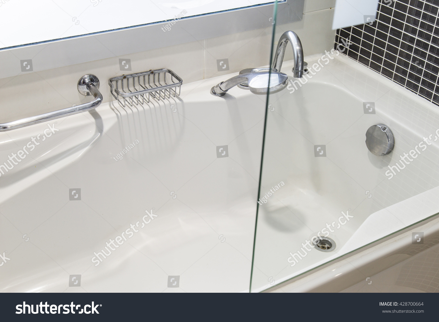 View of bath tube with day light from the window, very shallow depth ...