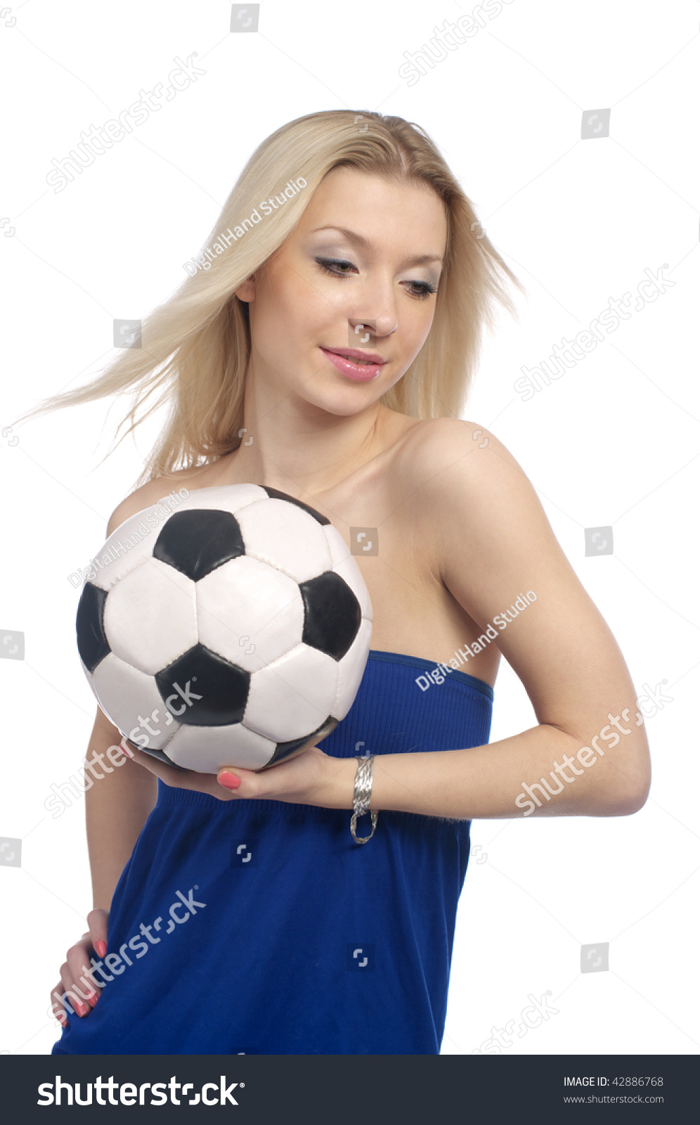 f914654aa Beautiful young female with a soccer ball isolated on the white background.