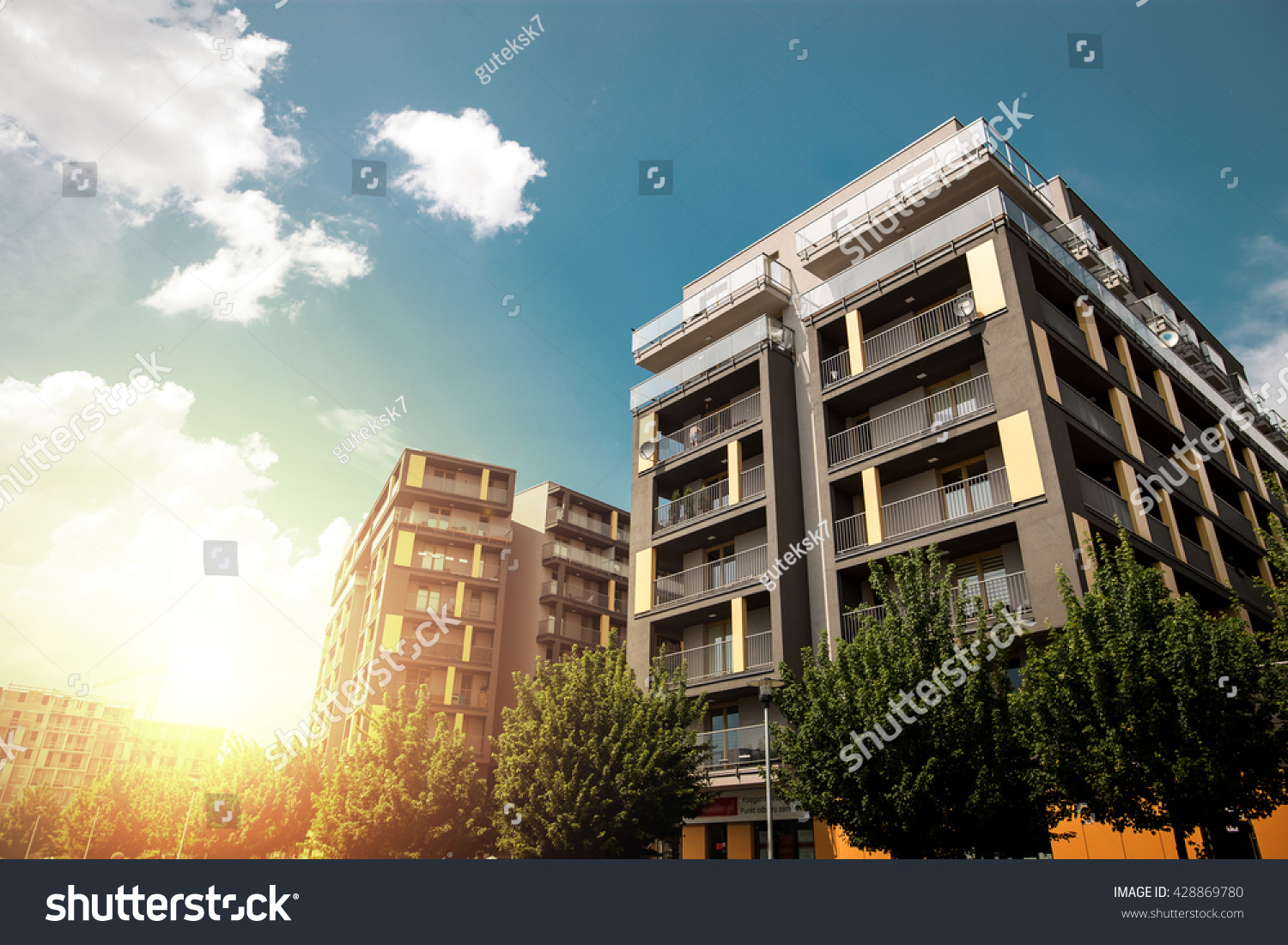 Modern apartment buildings exteriors in sunny day #428869780