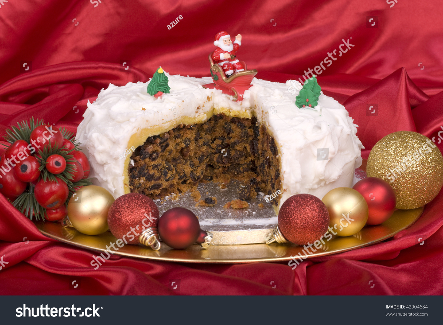 Home baked christmas cake with decorations stock photo for Baking oranges for christmas decoration