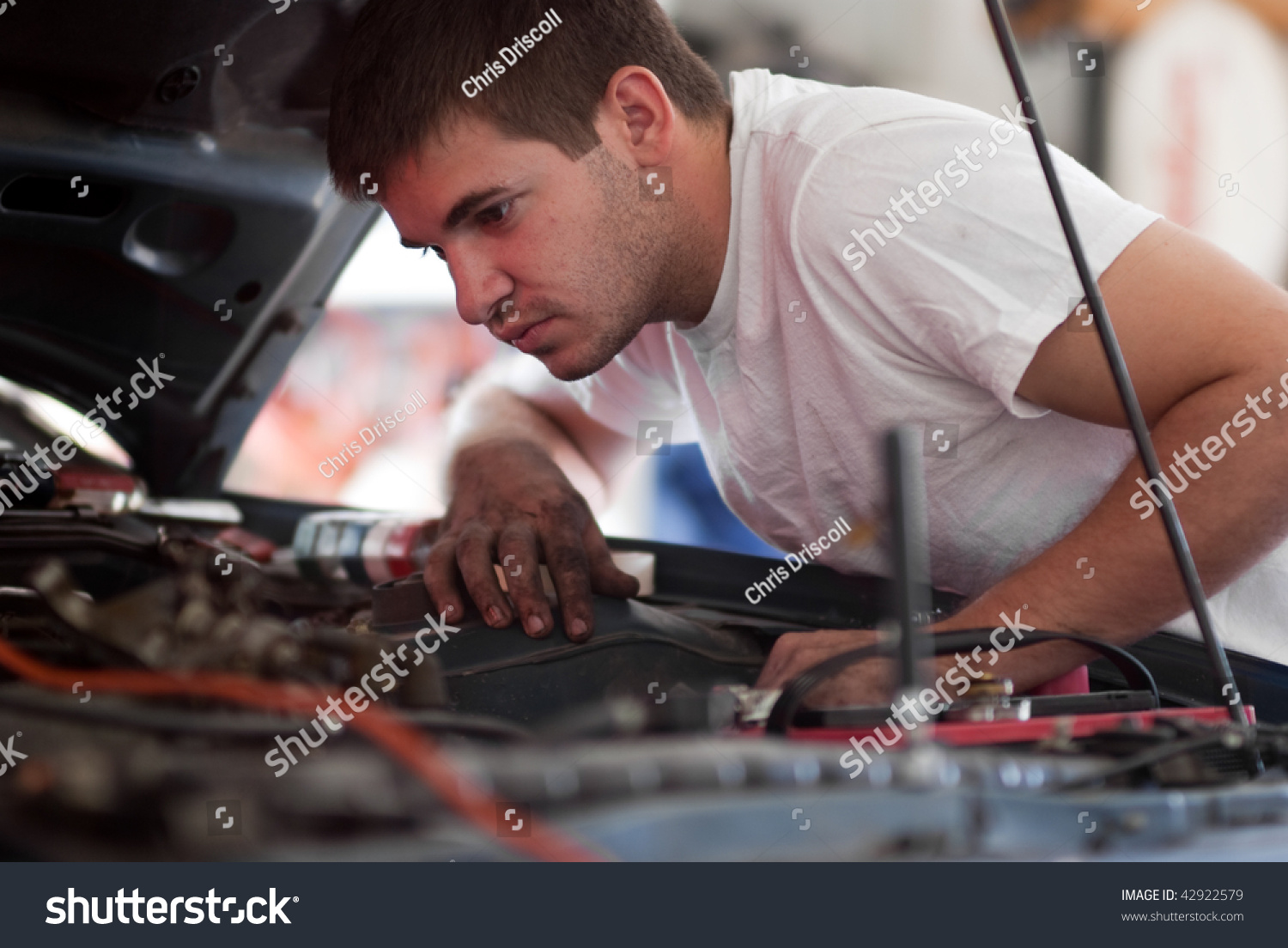 Car repair mechanic fixing auto man stock photo royalty free car repair mechanic fixing auto man working on car in garage at home do solutioingenieria Choice Image