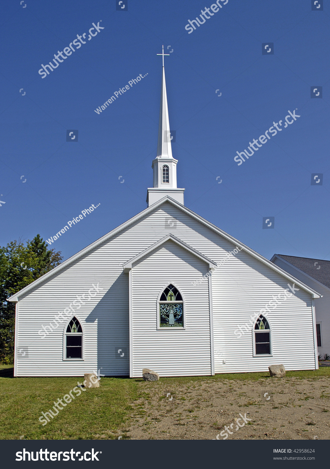 White Wood Siding Presbyterian Church And Steeple Against