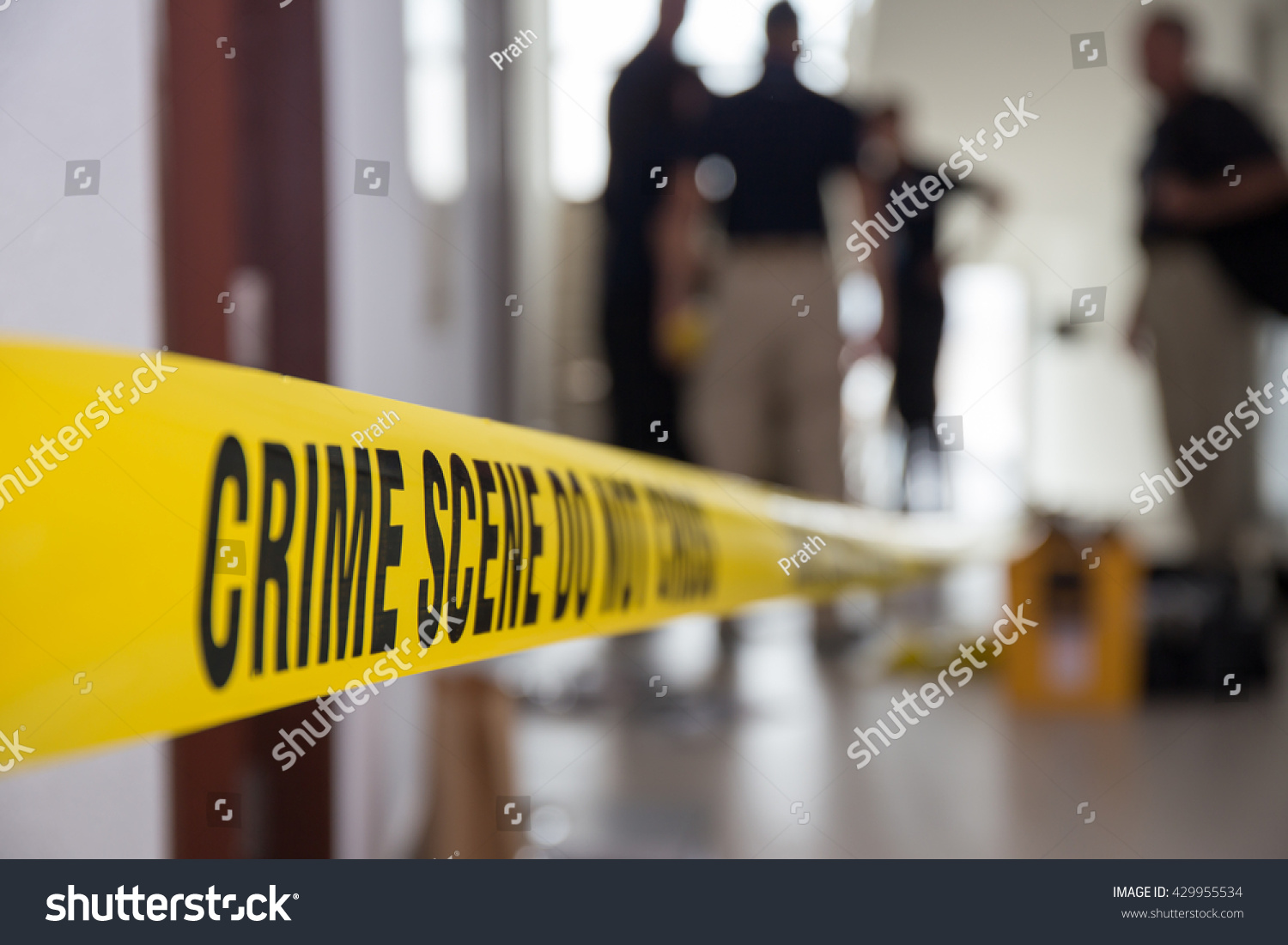 crime scene tape in building with blurred forensic team background #429955534 - 123PhotoFree.com