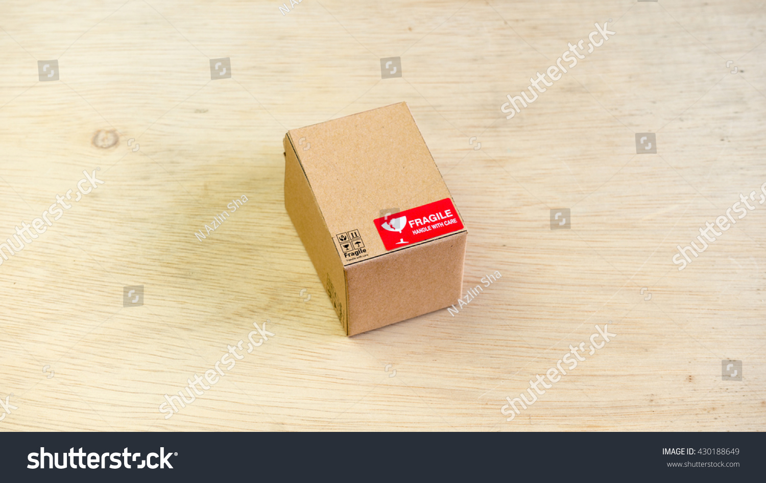 Cardboard boxes fragile wording symbol on stock photo 430188649 cardboard boxes with fragile wording symbol on wooden floor concept of handle with care courier buycottarizona