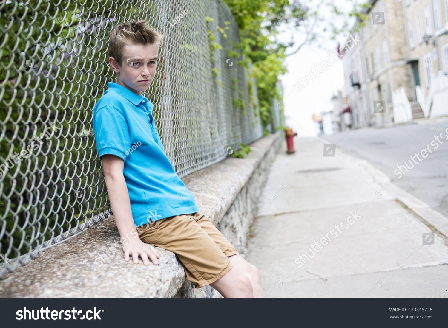 Young Teen Boy Looking Out Fence Stock Photo (Edit Now ...