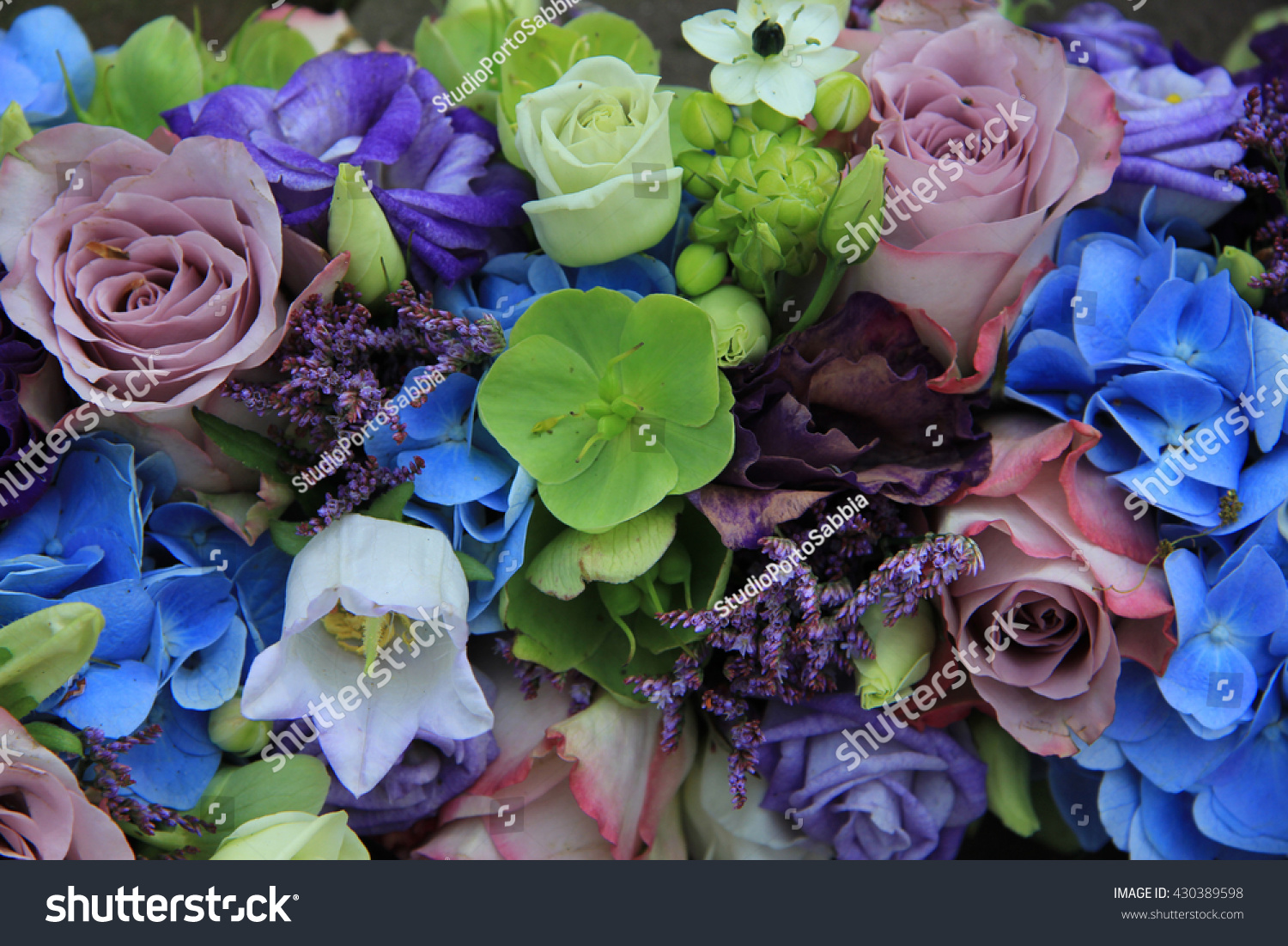 Blue Hydrangea And Purple Roses In A Blue Purple Wedding Bouquet And